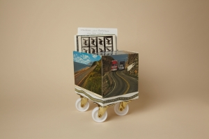 Postcart, Andra Samelson (NYC & Delhi, NY), 2014, postcards, plastic wheels, 6 in. w. x 10 in. h. x 6 in. l